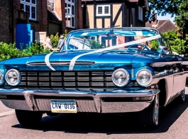 Blue Oldsmobile for wedding hire in Windsor